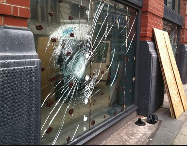 Vandal-attack-shop-from-glazier-in-Belfast-Northern-ireland-supply-and-install-shop-from-security-glass-derry-city-northern-ireland-glass-online